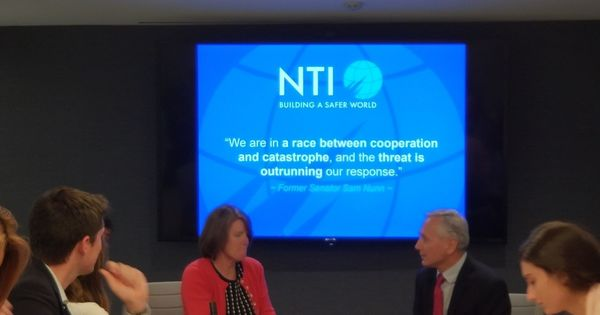 Summer Institute students at a briefing with Carmen MacDougall, NTI VP, Communications
